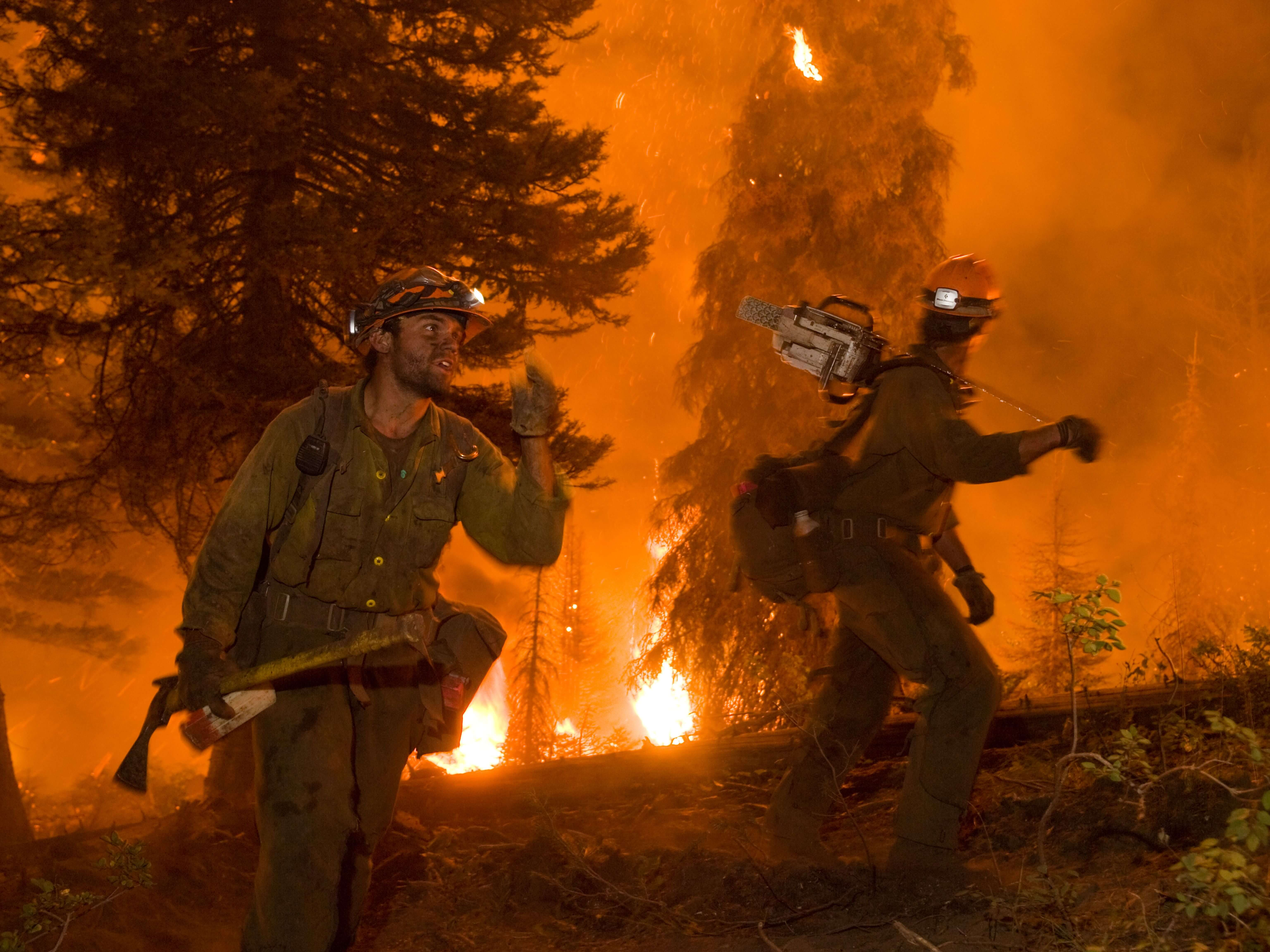 Two members of the Idaho City Hotshots work on the Springs Fire on the Boise National Forest, August, 2012. Hotshot crews are the best of the best of wildland fire fighters. They have been extensively trained to fight fires in remote areas with little or no logistical support in the most demanding conditions. (US Forest Service photo/Kari Greer) Photo Credit: USDA